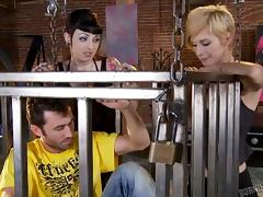 Punk babe with hot tattoos uses her caged sex slave to get off