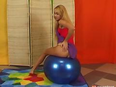 Practicing with her clothes off using a huge rubber ball