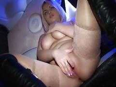 Seductive blonde enjoys anal masturbation in limo