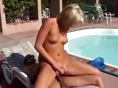 Two guys fuck a hot blonde slut, by the pool