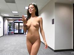 Public flasher babe walks around a building in the nude