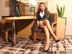 Stripping tranny babe in a secretary outfit looks blazing hot