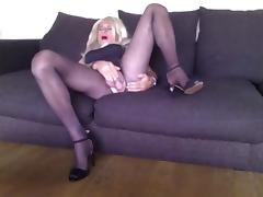 Sexy crossdresser playing on couch
