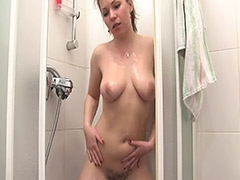 Slavic Babe with Huge Tits and Hairy Cunt Washes Her Fuck Hole in a Shower