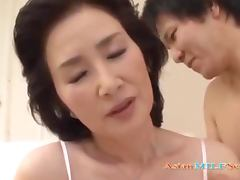 Mature Asian Woman Licked And Fingered By Young Guy On The Bed