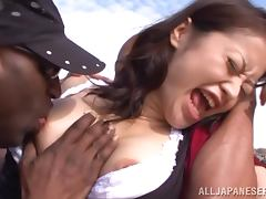 Japanese girl gets fucked by two Black guys at the beach