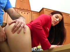 Hot redhead babe is riding on the hard dick in the kitchen