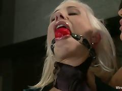 Two women are torturing a sassy and busty blondie