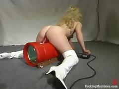 Divine blond siren is being penetrated by a machine