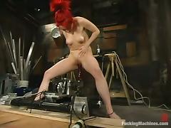 Sabrina Sparx moans crazily while riding a sex machine in a cellar