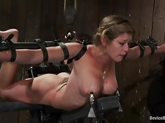 Two lewd milfs get chained and tormented in a cellar and enjoy it