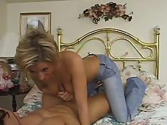 Blonde milf fingers her shaved vag while rubbing her man's wang