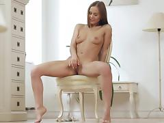 Young girl Sabina Moore plays with her shaved pussy