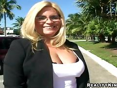 A curvy MILF in glasses rides a dick in the street