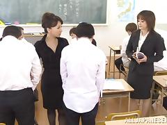 Asian teachers have fun with two students