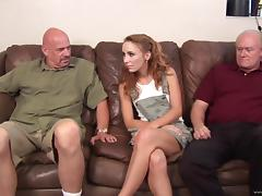 Curly Redhead Slut Handles Two Wrinkled Dicks At The Same Time