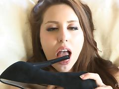 Depraved chick fucks her vagina with the heel of her stiletto